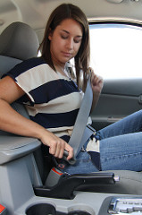 Teen Girl Buckling Seatbelt